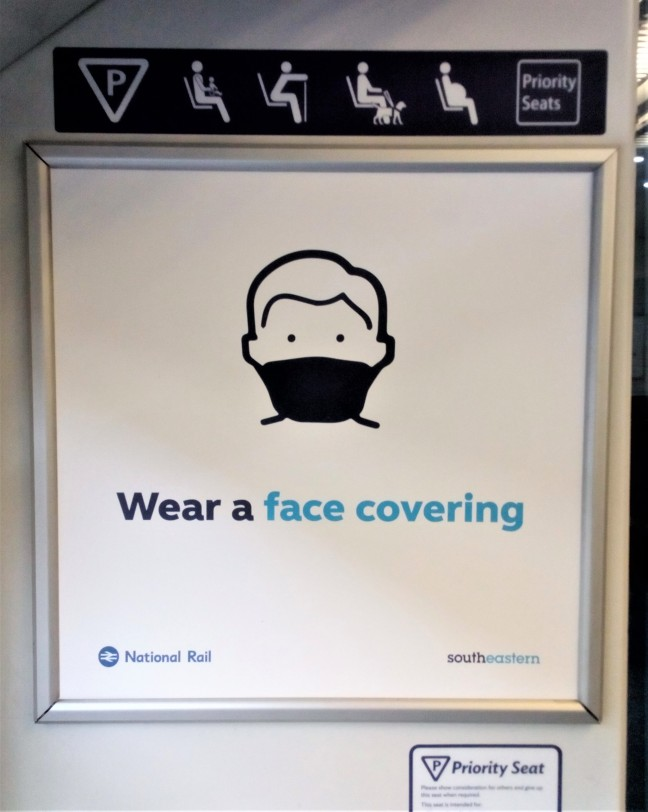 train sign saying wear a face covering