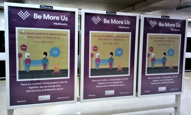 Advert hoarding for a charity. Says Be more us. Let's talk more.